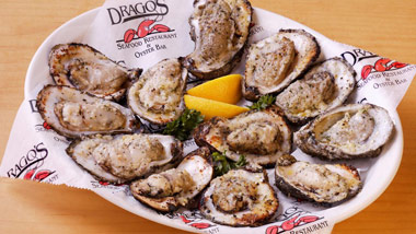 platter of cooked oysters with lemon