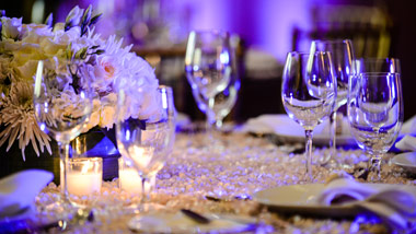 table setting with purple uplighting